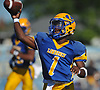 Christian Fredericks #1, Lawrence quarterback, throws a pass for a completion during a Nassau County Conference III varsity football game against Plainedge at Lawrence High School on Saturday, Sept. 23, 2017.