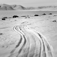 Tracks in the snow between Daneborg and the nearby research station ZERO (Zackenberg Ecological Research Operations). Established on the east coast of Greenland in 1950, Daneborg is the base for the Sirius Patrol, a Danish navy unit which patrols and enforces Danish sovereignty in the Arctic regions of Northern and Eastern Greenland.