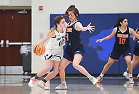 Har-Ber guard Maddux McCrackin (12) drives past Heritage Maddie Lynge (3), Friday, February 7, 2020 during a basketball game at Wildcat Arena at Har-Ber High School in Springdale. Check out nwaonline.com/prepbball/ for today's photo gallery.<br /> (NWA Democrat-Gazette/Charlie Kaijo)