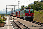 Train station of Madulain, the small Swiss town not far from St. Moritz, Switzerland as the Swiss red train pulls up