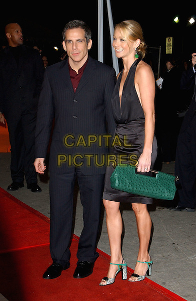 BEN STILLER & WIFE CHRISTINE TAYLOR.World Premiere of Warner Brother's Starsky & Hutch held at The Mann Village Theatre in Westwood, California .26 February 2004 .*UK Sales Only*.full length, full-length, little black dress halterneck, plunging neckline, cleavage, green handbag, shoes, heels, sandals.www.capitalpictures.com.sales@capitalpictures.com.©Capital Pictures.
