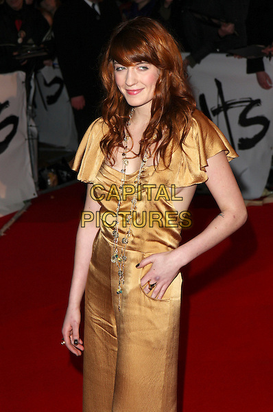 FLORENCE WELCH of Florence and the Machine.Arrivals - 2009 Brit Awards, Earls Court, London, England, .February 18th 2009.brits full length gold jumpsuit necklace pantsuit 3/4 cleavage .CAP/MAR.© Martin Harris/Capital Pictures.