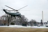 Marine One departs a snowy South Lawn of the White House, in Washington, D.C., February 1, 2019. United States President Donald J. Trump, first lady Melania Trump, and their son, Barron, were aboard en route to a weekend away in Florida.<br /> Credit: Martin H. Simon / CNP