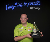 20.05.2015. London,  England. Betway Premier League Darts, Play-Offs Media Day. [L-R] World number one Michael van Gerwen with the Betway Premier League Trophy.