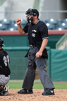 Home plate umpire Sam Vogt makes a calling during a game between the GCL Marlins and GCL Astros at Osceola County Stadium on June 25, 2011 in Kissimmee, Florida.  The Astros defeated the Marlins 5-2 after the game was ended in the sixth inning due to heavy rain.   (Mike Janes/Four Seam Images)