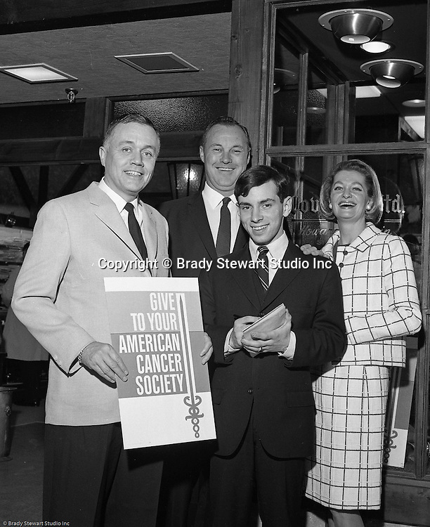 Pittsburgh PA: Jim Daniell of Daniell, Sapp and Boorn with other volunteers at the American Cancer Society Benefit at the new Allegheny Center Mall on the North Side of Pittsburgh - 1966.  The Daniell, Sapp and Boorn agency put on the event to benefit the American Cancer Society and the new Allegheny Center Mall.  The mall recently opened and extra publicity is always a good thing.  Daniell Sapp and Boorn which opened in 1962, was active in helping good causes which indirectly promoted their insurance services. During the 1950's and 1960's local corporations and companies were very active in supporting non-profit and charitable organizations.