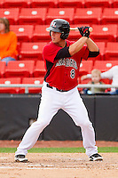 Andrew Clark #8 of the Hickory Crawdads at bat against the Greensboro Grasshoppers at L.P. Frans Stadium on May 18, 2011 in Hickory, North Carolina.   Photo by Brian Westerholt / Four Seam Images
