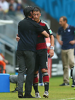 Germany coach Joachim Loew hugs Mesut Ozil after he is substituted