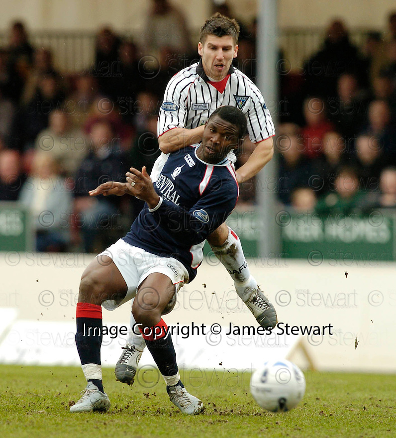 15/04/2006         Copyright Pic: James Stewart.File Name : sct_jspa05_falkirk_v_dunfermline.MARK BURCHILL AND JEAN LECSINEL CHALLENGE FOR THE BALL... Payments to :.James Stewart Photo Agency 19 Carronlea Drive, Falkirk. FK2 8DN      Vat Reg No. 607 6932 25.Office     : +44 (0)1324 570906     .Mobile   : +44 (0)7721 416997.Fax         : +44 (0)1324 570906.E-mail  :  jim@jspa.co.uk.If you require further information then contact Jim Stewart on any of the numbers above.........