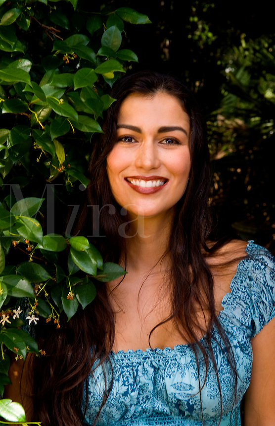 Beautiful hispanic woman from Columbia in Souith America portrait with plants showing beautiful eyes and face