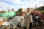 Palestinians inspect the home of the Ibrahim Diab and his daughter Dina was demolished by the Israeli military in the Sheikh Jarrah neighborhood of occupied East Jerusalem on Dec. 16, 2015. The home was 85 square meters and home to six family members, and Israeli forces demolished the home on the grounds that it was constructed without permission from the municipality, Dina said. Over 6,000 homes were demolished immediately after the occupation began and four neighborhoods were razed entirely, according to documentation by the Israeli Committee Against House Demolitions. The group has documented nearly 50,000 demolitions in the occupied Palestinian territory since. Photo by Mahfouz Abu Turk