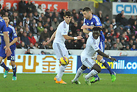SWANSEA, WALES - JANUARY 17:   of  during the Barclays Premier League match between Swansea City and Chelsea at Liberty Stadium on January 17, 2015 in Swansea, Wales. <br /> Swansea's Bafetimbi Gomis taking a tumble
