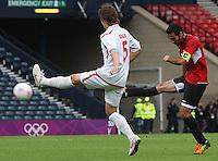 Men's Olympic Football match Egypt v Belarus on 1.8.12...Mohamed Aboutrika of Egypt shooting and Dmitry Baga of Belarus, during the Men's Olympic Football match between Egypt v Belarus at Hampden Park, Glasgow.
