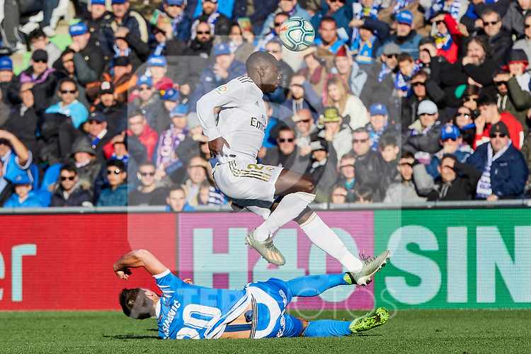 Ferland Mendy of Real Madrid and Nemanja Maksimovic of Getafe FC during La Liga match between Getafe CF and Real Madrid at Coliseum Alfonso Perez in Getafe, Spain. January 04, 2020. (ALTERPHOTOS/A. Perez Meca)