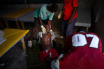 © Remi OCHLIK/IP3 - Gonaives on 2010 november 10 - A three-week-old cholera epidemic that has killed more than 640 people in Haiti is spreading quickly in the northwest coastal city of Gonaive.People look for dead bodies in the streets of the city