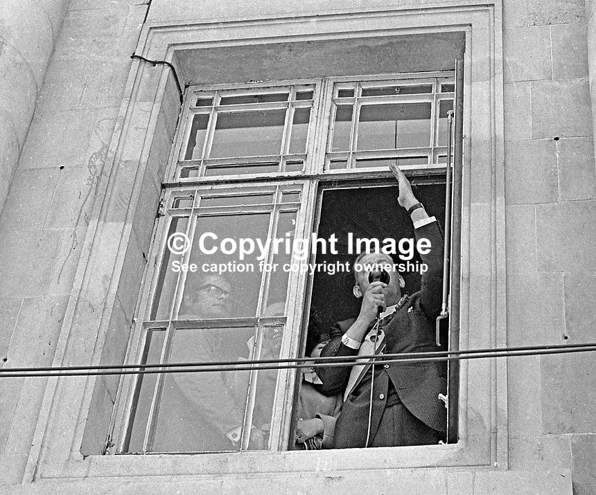 In more typical pose, Rev Ian Paisley, addresses his supporters from an upstairs window at Ballymena Town Hall, after winning the North Antrim seat by defeating the incumbent Ulster Unionist, Henry Maitland Clark, in the 1970 UK General Election. Clark had held the seat during three previous parliaments. 197006190230c.<br /> <br /> Copyright Image from Victor Patterson, 54 Dorchester Park, <br /> Belfast, UK, BT9 6RJ<br /> <br /> t1: +44 28 9066 1296 (from Rep of Ireland 048 9066 1296)<br /> t2: +44 28 9002 2446 (from Rep of Ireland 048 9002 2446)<br /> m: +44 7802 353836<br /> <br /> e1: victorpatterson@me.com<br /> e2: victorpatterson@gmail.com<br /> www.victorpatterson.com<br /> <br /> Please see my Terms and Conditions of Use at www.victorpatterson.com. It is IMPORTANT that you familiarise yourself with them.<br /> <br /> Images used on the Internet must be visibly watermarked i.e. &copy; Victor Patterson<br /> within the body of the image and copyright metadata must not be deleted. Images <br /> used on the Internet have a size restriction of 4kbs and will be chargeable at current<br />  NUJ rates unless agreed otherwise.<br /> <br /> This image is only available for the use of the download recipient i.e. television station, newspaper, magazine, book publisher, etc, and must not be passed on to any third <br /> party. It is also downloaded on condition that each and every usage is notified within 7 days to victorpatterson@me.com<br /> <br /> The right of Victor Patterson to be identified as the author is asserted in accordance with The Copyright Designs And Patents Act (1988).
