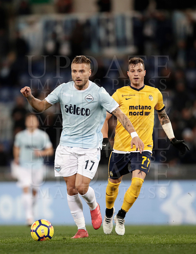 Calcio, Serie A: SS Lazio vs Hellas Verona, Roma, stadio Olimpico, 19 febbraio 2018.<br /> Lazio's Ciro Immobile (l) in action with Verona's Marcel Buchel (r) during the Italian Serie A football match between SS Lazio and Hellas Verona at Rome's Olympic stadium, February 19, 2018.<br /> UPDATE IMAGES PRESS/Isabella Bonotto