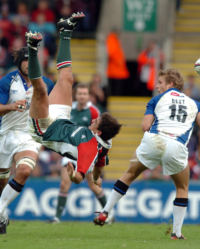 Photo. Henry Browne. Leicester v Bath. Zurich Premiership. 09/10/2004..Harry Ellis gets sent flying by Lee Best.