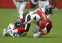 Aug 18, 2007; Glendale, AZ, USA; Arizona Cardinals quarterback Matt Leinart (7) is tackled by the Houston Texans during the first quarter at University of Phoenix Stadium. Mandatory Credit: Mark J. Rebilas-US PRESSWIRE Copyright © 2007 Mark J. Rebilas