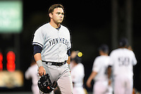 Tampa Yankees designated hitter Dante Bichette Jr. (25) walks off the field after a game against the Lakeland Flying Tigers on April 5, 2014 at Joker Marchant Stadium in Lakeland, Florida.  Lakeland defeated Tampa 3-0.  (Mike Janes/Four Seam Images)