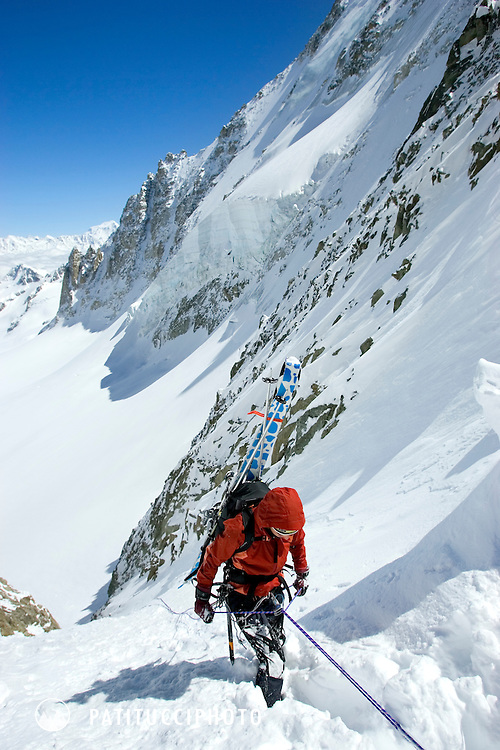 Skier rappeling couloir from the top of the Col du Chardonnet on the first day of the Haute Route. Chamonix, France