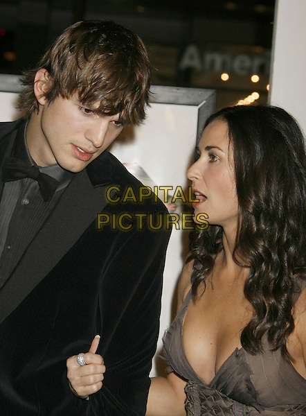 "ASHTON KUTCHER & DEMI MOORE.AFI Fest 2006 Opening Night Gala and US Premiere of ""Bobby"" held at Mann's Chinese Theatre, Hollywood, California, USA..November 1st, 2006.Ref: ADM/RE.headshot portrait brown grey gray black suit husband wife couple married profile.www.capitalpictures.com.sales@capitalpictures.com.©Russ Elliot/AdMedia/Capital Pictures."