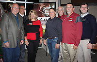 NWA Democrat-Gazette/CARIN SCHOPPMEYER Bob Arthur (from left), Marty and Vickie Burlsworth, Brian Reindl, Tim McFarland and Sean Bedford welcome guests to the Burlsworth Trophy reception Dec. 4.