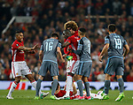 Eric Bailly of Manchester United starts out as peacemaker before the melee got out of control during the Europa League Semi Final 2nd Leg match at Old Trafford Stadium, Manchester. Picture date: May 11th 2017. Pic credit should read: Simon Bellis/Sportimage