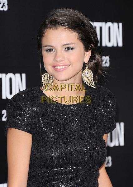 """Selena Gomez  .The Premiere of """"Abduction""""  held at The Grauman's Chinese Theatre in Hollywood, California, USA..September 15th, 2011.half length black sparkly top dangling gold earrings leaf leaves.CAP/RKE/DVS.©DVS/RockinExposures/Capital Pictures."""