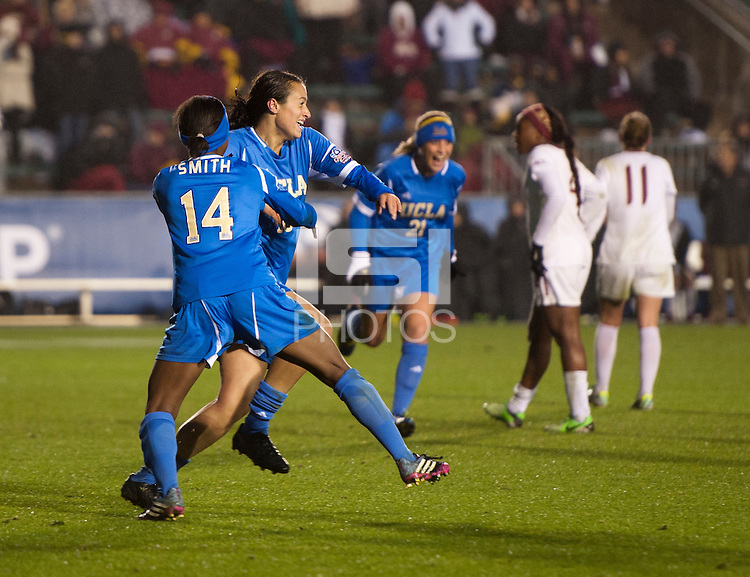 Kodi Lavrusky (10) of UCLA celebrates her goal with teammate Taylor Smith (14) during the NCAA Women's College Cup finals at WakeMed Soccer Park in Cary, NC.  UCLA defeated Florida State, 1-0, in overtime.