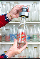 BNPS.co.uk (01202 558833)<br /> Pic: RachelAdams/BNPS<br /> <br /> A 'hand capper' used to seal bottles.<br /> <br /> In a glass of his own...<br /> <br /> Dairy-daft Peter Hayward is udderly devoted to his bizarre hobby - collecting vintage milk bottles.<br /> <br /> The 70-year-old has devoted the last 30 years to building up a whopping collection of more than 1,000 bottles.<br /> <br /> Peter, a former dairy worker, scours the south west of Britain in search of rare bottles emblazened with the colourful logos of old dairies.<br /> <br /> And since retiring 16 years ago his collection has swelled so much that he has been forced to turn his garage into a mini museum.<br /> <br /> Peter's obsession with milk started as a 10-year-old when he helped his local milkman on his weekend rounds to earn some pocket money.<br /> <br /> He later joined Express Dairies as a distribution manager, working alongside hundreds of independent dairy farmers.<br /> <br /> When he retired in the late 1990s Peter had amassed a sizeable collection in his office - and decided to devote his free time to growing it.