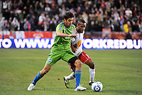 Leonardo Gonzalez (12) of the Seattle Sounders battles for the ball with Dane Richards (19) of the New York Red Bulls. The New York Red Bulls defeated the Seattle Sounders 1-0 during a Major League Soccer (MLS) match at Red Bull Arena in Harrison, NJ, on March 19, 2011.