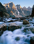 Banff National Park, Alberta, Canada<br /> Swift water on Moraine Creek flowing from Moraine Lake under Wenkchemna Peaks of the Canadian Rockies