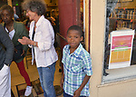 "Neighborhood youth, ""Wisey"" age 9, greeting people at the door outside, the ""An Evening of Real History"" event, at the A.J. Williams-Myers African Roots Center, in Kingston, NY, on Saturday, July 29, 2017. Photo by Jim Peppler. Copyright/Jim Peppler-2017."