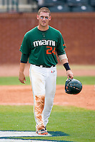 Yasmani Grandal #24 of the Miami Hurricanes after making the third out of an inning against the Boston College Eagles at the 2010 ACC Baseball Tournament at NewBridge Bank Park May 27, 2010, in Greensboro, North Carolina.  The Eagles defeated the Hurricanes 12-10 in 10 innings.  Photo by Brian Westerholt / Four Seam Images