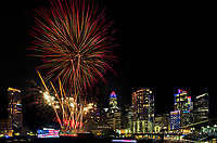 Fireworks from Skyshow Charlotte  2018 explode over BB&T Ballpark against the backdrop of the Charlotte NC skyline as the city celebrated the July 4th holiday in 2018. Photographer has fireworks celebrations in Charlotte from multiple years. The collection of Charlotte NC fireworks photos show different perspectives and weather conditions.<br /> <br /> Charlotte Photographer - PatrickSchneiderPhoto.com