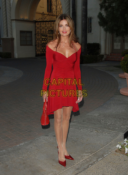 TRACY SCOGGINS.The FX Season 4 Premiere Screening of Nip/Tuck held at The Paramount Studios in Hollywood, California, USA..August 25th, 2006.Ref: DVS.Nip Tuck full length red dress purse shoes.www.capitalpictures.com.sales@capitalpictures.com.©Debbie VanStory/Capital Pictures