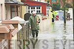 Eddie Lacey walks through Flooding at Ballymullen Tralee on Thursday
