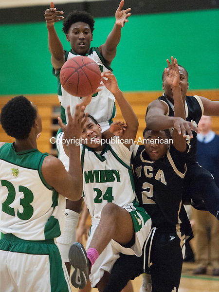 WATERBURY, CT- 20 January 2016-012016EC03-   Players from Wilby and Waterbury Career battle for a rebound Wednesday night. From L to R: Wilby's (23) Ahmad Alves, (25) Damian Grant, and (24) Nasir Smith and Waterbury Career's (2) Jaden Battle and (13) Chad McKoy. Erin Covey Republican-American