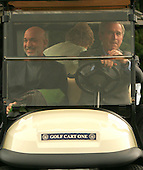 Camp David, MD - August 5, 2007 -- United States President George W. Bush gives  President Hamid Karzai of Afghanistan a ride as first lady Laura Bush rides in the  backseat of a VIP golfcart at Camp David, Maryland on Sunday, August 5, 2007..Credit: Dennis Brack - Pool via CNP