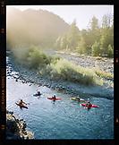 USA, California, Forks of Salmon, people kayaking on the Salmon River at sunset, Otter Bar Kayaking School