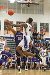 San Marcos' Cory Mathis fouls Cedar Ridge's Tim Holland Friday at Cedar Ridge Gym.  The Raiders beat the Rattler's 88-87 in overtime.  (LOURDES M SHOAF for Round Rock Leader.)