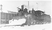 Engineer Winfield G. Laube beside RGS 2-8-0 #42 with snow on her plow at Dolores.<br /> RGS  Dolores, CO  ca 1949