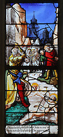 Saints Crispin and Crispinian, patron saints of cobblers, at Soissons, being drowned in the river with millstones round their necks while the governor Rictus Varus looks on, from the Scenes of the Life and Martyrdom of Saints Crispin and Crispinian stained glass window, attributed to Nicolas le Prince, donated in 1530 by the cobblers guild in Gisors, in the Collegiate Church of Saint-Gervais-Saint-Protais, built 12th to 16th centuries in Gothic and Renaissance styles, in Gisors, Eure, Haute-Normandie, France. The church was consecrated in 1119 by Calixtus II but the nave was rebuilt from 1160 after a fire. The church was listed as a historic monument in 1840. Picture by Manuel Cohen
