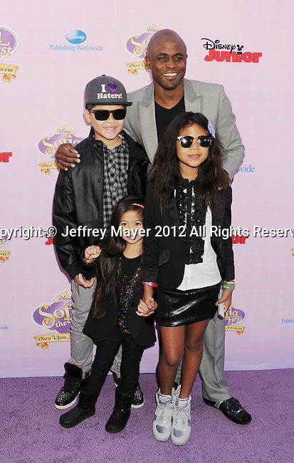 """BURBANK, CA - NOVEMBER 10: Wayne Brady and family arrive at the Disney Channel's Premiere Party For """"Sofia The First: Once Upon A Princess"""" at the Walt Disney Studios on November 10, 2012 in Burbank, California."""