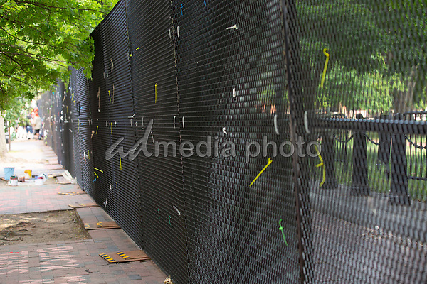Ties are left over from signs that were displayed on the additional White House fencing in Washington D.C., U.S., on Wednesday, June 10, 2020.  Additional fencing had been set up near the White House in response to the demonstrations caused by the death of George Floyd while he was in police custody on May 25, 2020.  Credit: Stefani Reynolds / CNP/AdMedia