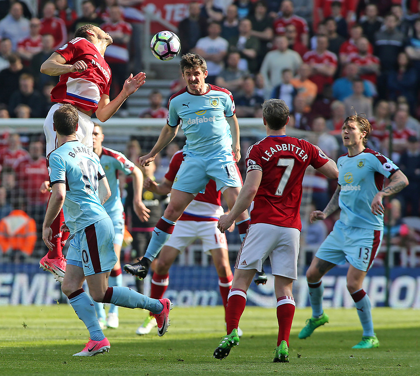 Burnley's Joey Barton heads clear from Middlesbrough's Rudy Gestede<br /> <br /> Photographer David Shipman/CameraSport<br /> <br /> The Premier League - Middlesbrough v Burnley - Saturday 8th April 2017 - Riverside Stadium - Middlesbrough<br /> <br /> World Copyright &copy; 2017 CameraSport. All rights reserved. 43 Linden Ave. Countesthorpe. Leicester. England. LE8 5PG - Tel: +44 (0) 116 277 4147 - admin@camerasport.com - www.camerasport.com