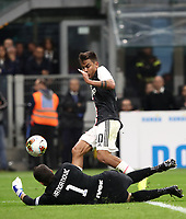Calcio, Serie A: Inter Milano - Juventus, Giuseppe Meazza stadium, October 6 2019.<br /> Juventus Paulo Dybala (top) in action with Inter's goalkeeper Samir Handanovic (bottom) during the Italian Serie A football match between Inter and Juventus at Giuseppe Meazza (San Siro) stadium, October 6, 2019.<br /> UPDATE IMAGES PRESS/Isabella Bonotto