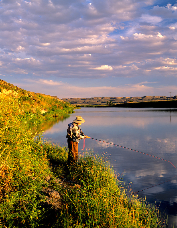 Fly fisherman on banks of Owyhee River. Near Rome, Oregon.
