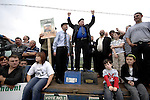 KILGARVAN SUNDAY 29-4-07: Independent South Kerry TD Jackie Healy-Rae was quick off the mark with the first eletion rally of the campaign outside his local church when he mounted a tractor and trailer to deliver his manifesto surrounded by his supporters. Deputy Healy-Rae relies on old style election campaigning with emphasis on after mass rallies.<br /> Picture by Don MacMonagle